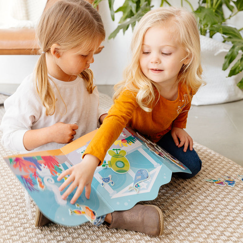 2 children playing with the Play Again! Reusable Sticker Scenes - Mermaid Magic