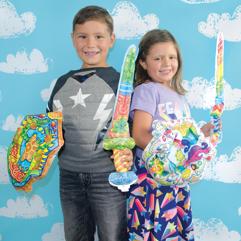 Boy and girl holding 3D Colorables Dragon and Unicorn Shields and Swords