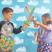 Boy and girl playing with 3D Colorables Dragon and Unicorn shield and swords inflatable toys
