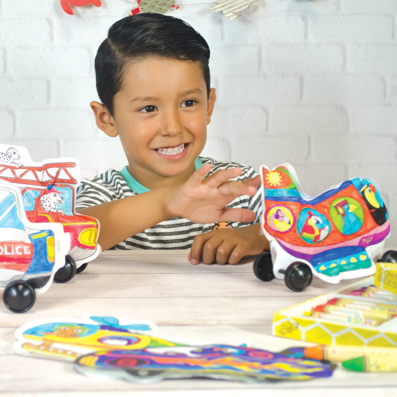 Boy playing with 3D Colorables paper coloring toys