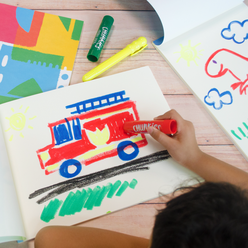 Kid painting fire truck with Chunkies Paint Sticks