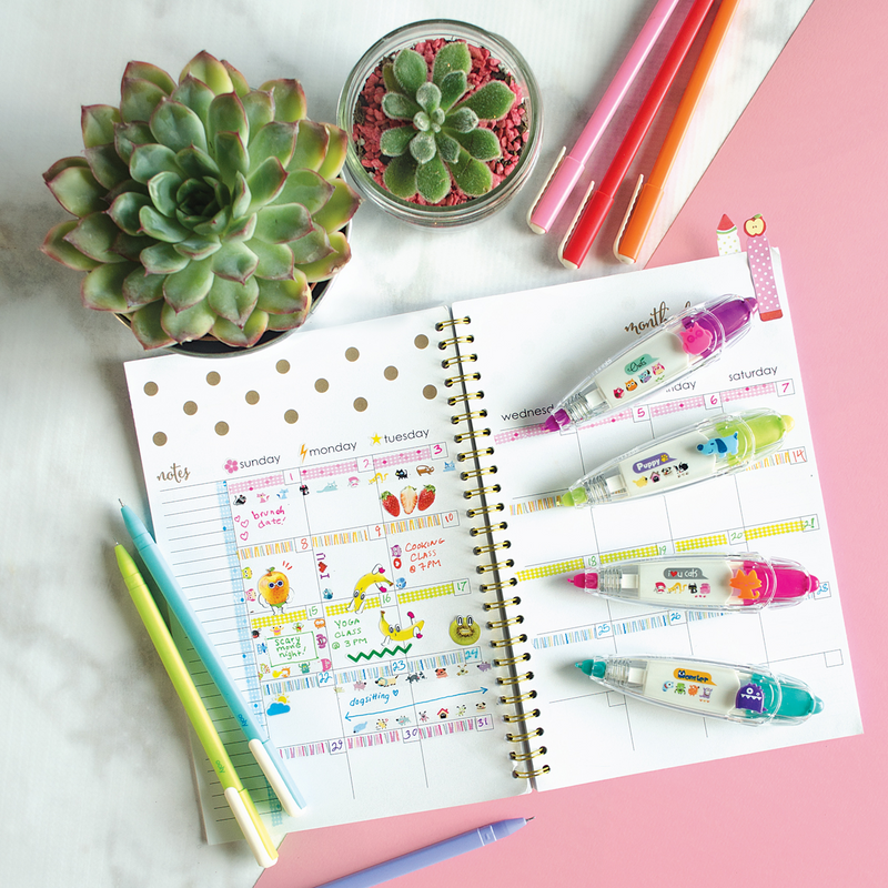 Modern Writers gel pens on a desk setting with a planner