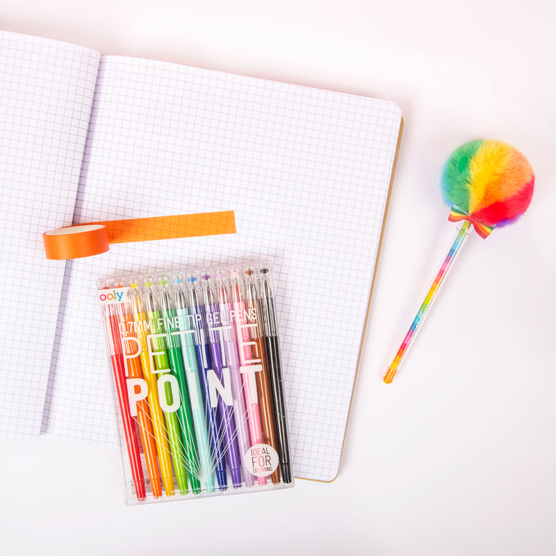 Rainbow Brite Sakox Lollypop Pen next to grid paper notebook and Petite Point Pens
