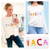 White VACAY Sweater with Braided Multicolor Yarn Embroidery & HighLow Hem