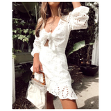 White Eyelet Tie Front Puff Sleeve Dress with Asymmetrical Ruffle Hem