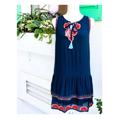 Navy Sleeveless Drop Hem Dress with Bright Orange Starburst Embroidery & Tassel Ties