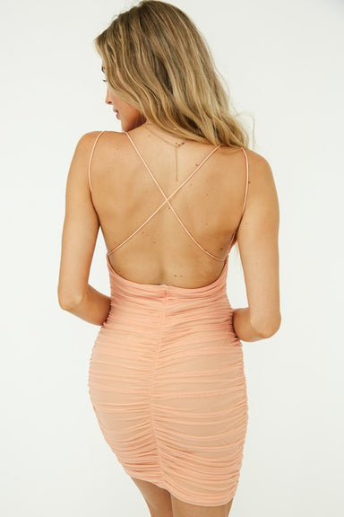 Peach Mesh Ruched Dress with crisscross back to wear to the club.
