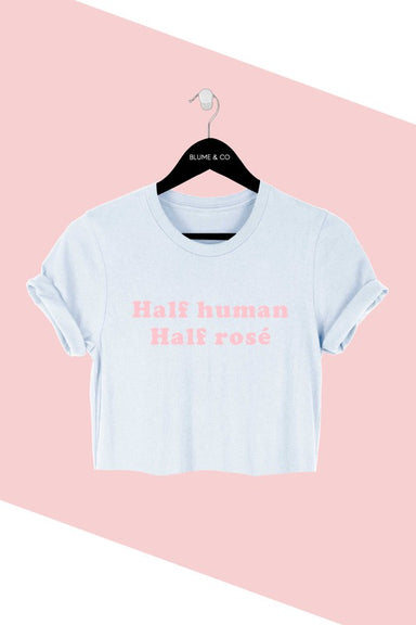 HALF HUMAN HALF ROSÉ  Designed for comfort and style. This tee is made from premium cotton  and features a classic fit. Pair with your favorite denim for a fun happy hour look.