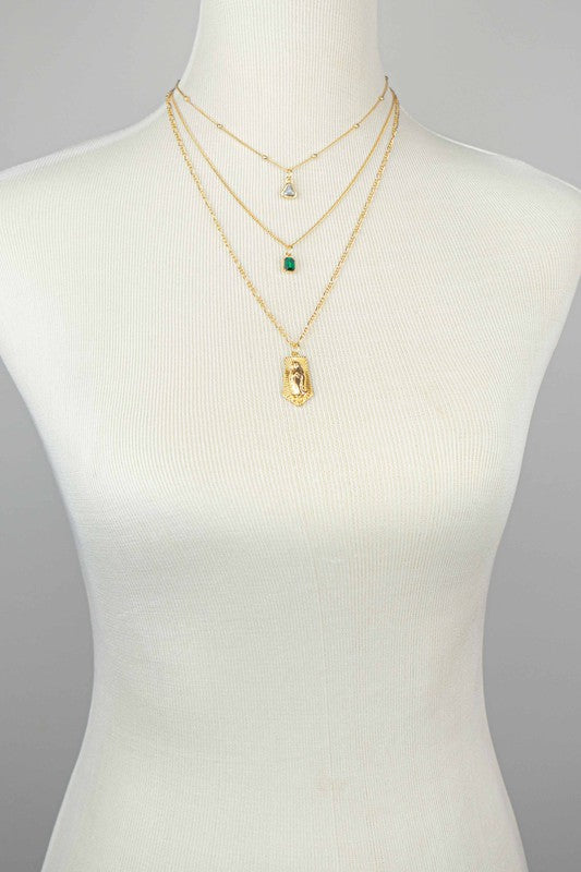 "THREE ROW STONE AND VIRGIN MARY PENDANT NECKLACE FEATURING A CLEAR TRIANGLE RHINESTONE AND EMERALD RECTANGLE STONE SIZE: 16-18-22"" + 3"" EXTENSION"