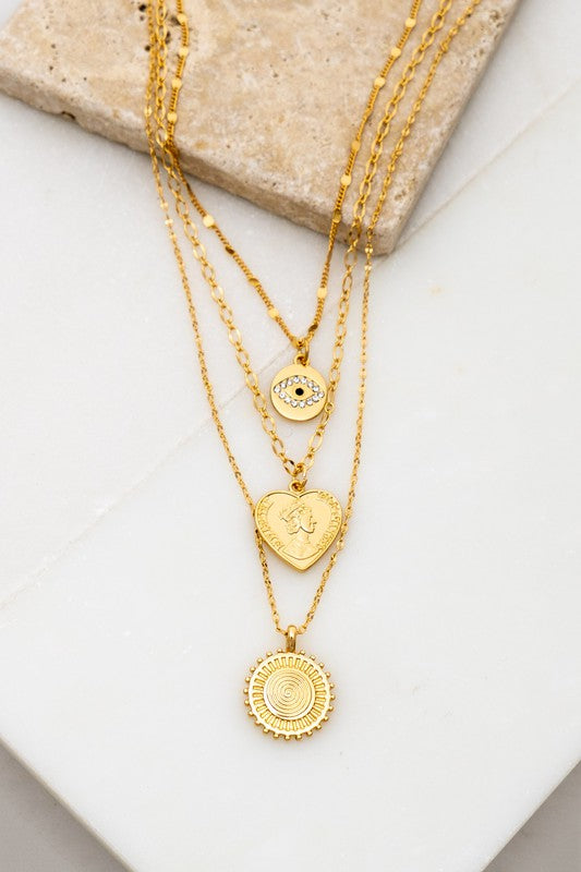TWO NECKLACES SET: 1. TWO LAYER CHARM NECKLACE WITH AN EYE DISK AND A HEART COIN  2. SWIRL COIN CHARM NECKLACE