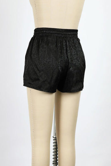 Black and back of ANIMAL PRINTED SATIN SHORTS WITH DRAWSTRING WAIST.