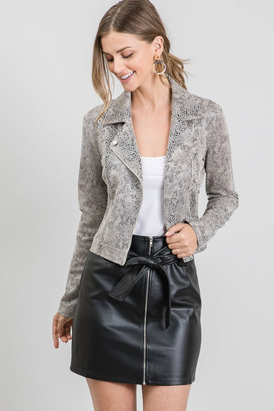 "Taupe Snake Suede Moto Jacket - Faux Suede (Polyester 90%, Spandex 10%) - Fabric is Slightly Stretchy - Motorcycle Jacket Style - Tack Button on Upper Zipper - Junior & Young Contemporary Fit - Designed in the US - Made in China - Color: Taupe Model is wearing SMALL size. 32B Chest, 24"" Waist, 35"" Hips"