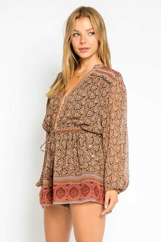 Our Brown Tapestry Romper features a button-up front and tassel tipped drawstrings. Woven.