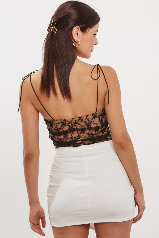 black strappy lace bodysuit that ties on the shoulders.