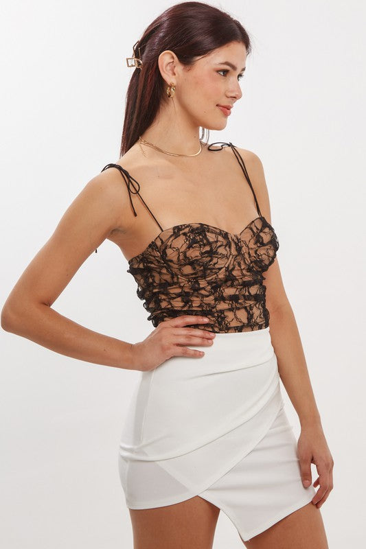 Black lace bustier bodysuit with white skirt