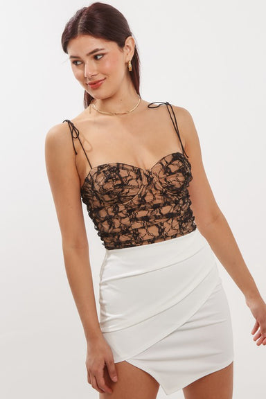Black lace bustier bodysuit with white skirt for a dressy night out with friends.
