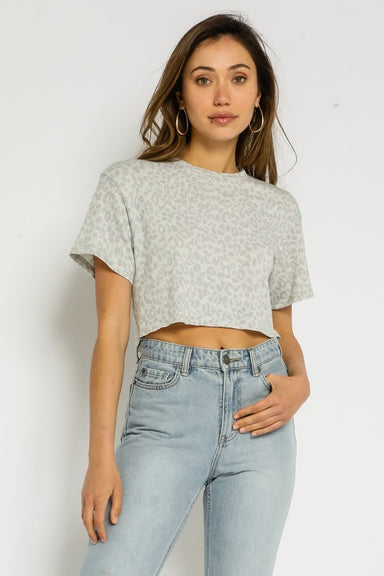 Our Leopard Cropped Tee features a crew neck and relaxed fit.