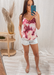 Women's silk pink tie-dye strappy top with adjustable straps! Pink tie-dye top worn with white linen shorts for a casual look.