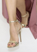 Ali simple gold heels with thin ankle strap.. Front view