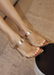 Audrey slip on rose gold heels with clear strap across the toes. Front view