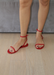 Aria scarlet jelly sandals with studded strap across the toes and ankle strap.