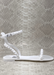WHITE STUDDED ARIA SANDAL THAT WRAP AROUND THE ANKLE WITH A BUCKLE AND ONE STRAP IN THE FRONT. Side view