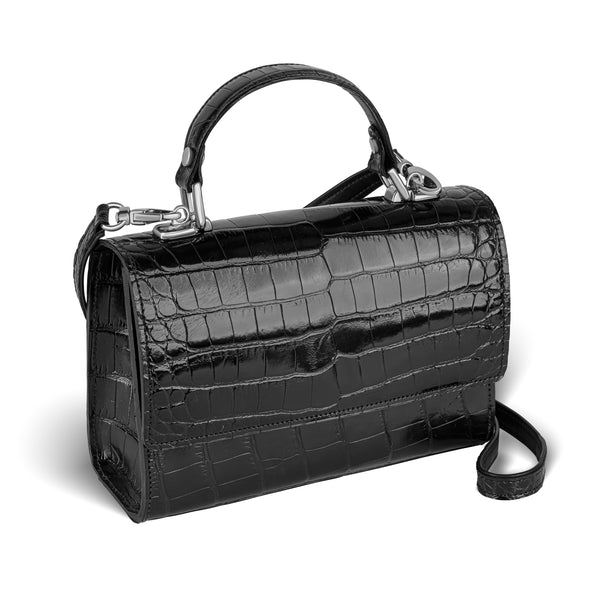 side view of responsible luxury leather top-handle handbag, the Soho handbag by piper & skye