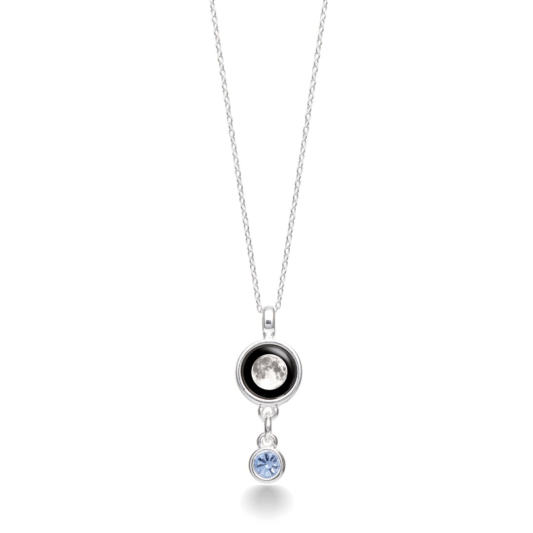 6caa72415c2 The Birthstone Satellite necklace features an aquamarine suspended from your  unique moon phase. A delicate silver chain allows this necklace to be worn  for ...