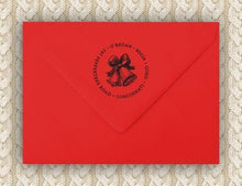 Bow Personalized Self-inking Round Return Address Stamp on Envelope