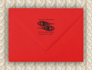 Snowshoes Holiday Personalized Self-inking Round Return Address Stamp on red envelope