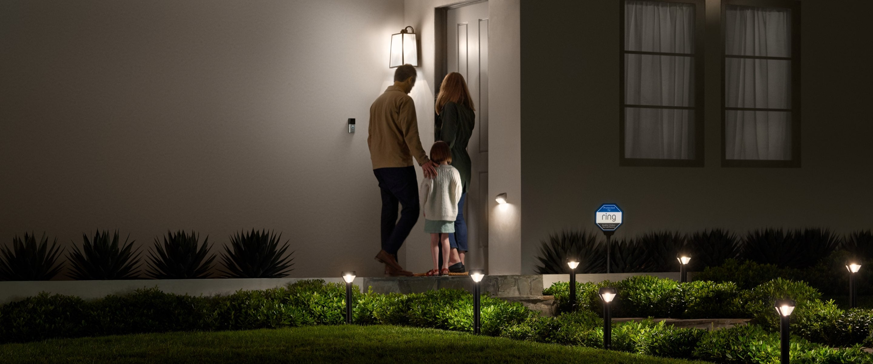 A family reaching home, all under the smart lights from ring