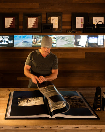 Peter Lik flipping through his epic book, Equation of Time in his corporate studios in Las Vegas, Nevada.