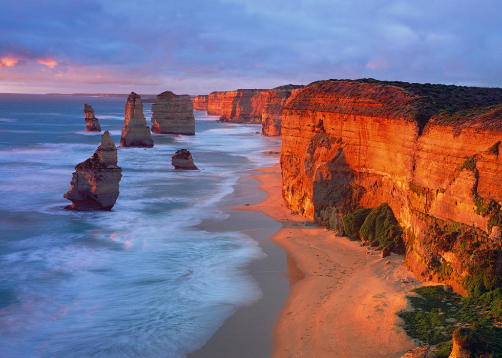 Twelve Apostles by Peter Lik is a landscape photograph of limestone off the shore of Port Cambell National Park, Australia