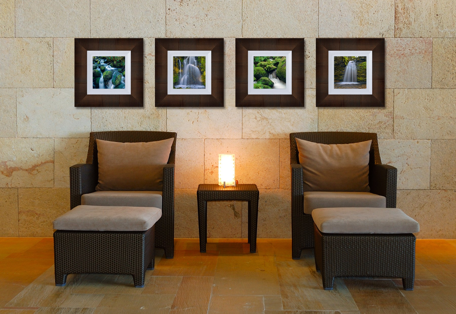 Spa waiting area with two chairs with ottomans featuring four square photographs of waterfalls by Peter Lik in brown frames with with liners