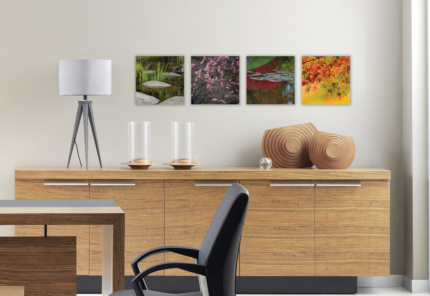 Modern dining room with light brown wood console table with sculpture and lamp featuring four square photographs by Peter Lik of traditional Zen gardens