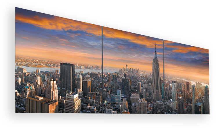 Framed three panel photograph of the Manhattan, New York skyline at twilight featuring the Empire State Building