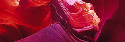 Red and pink wave shaped sandstone walls of the slot canyons in Antelope Canyon Arizona