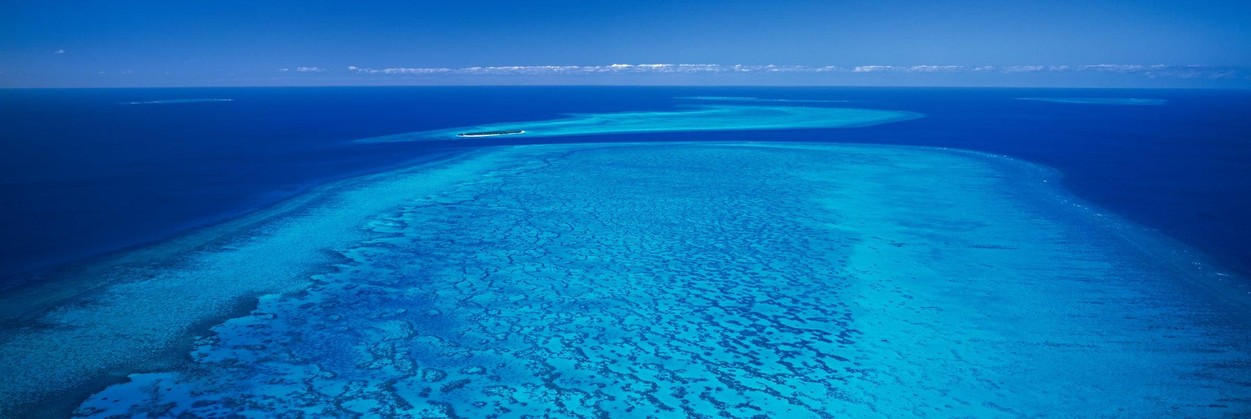Aerial view of the Great Barrier Reef and ocean in Queensland Australia