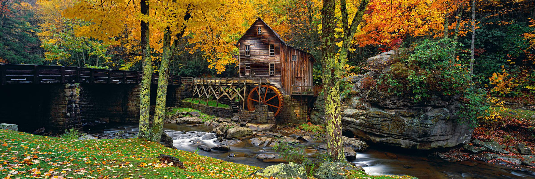 Old wooden Glade Creek Grist Mill on the rivers edge in the Appalachian Mountains during Fall