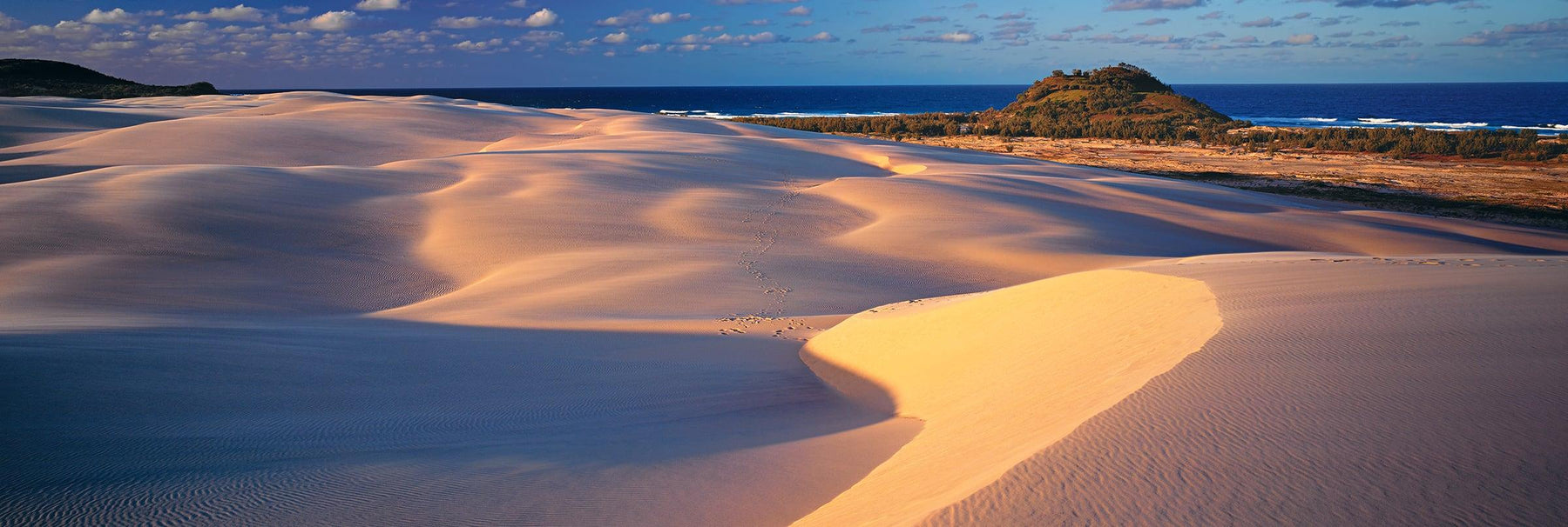 Windswept sand dunes covered with shadows along the coast of Fraser Island Australia
