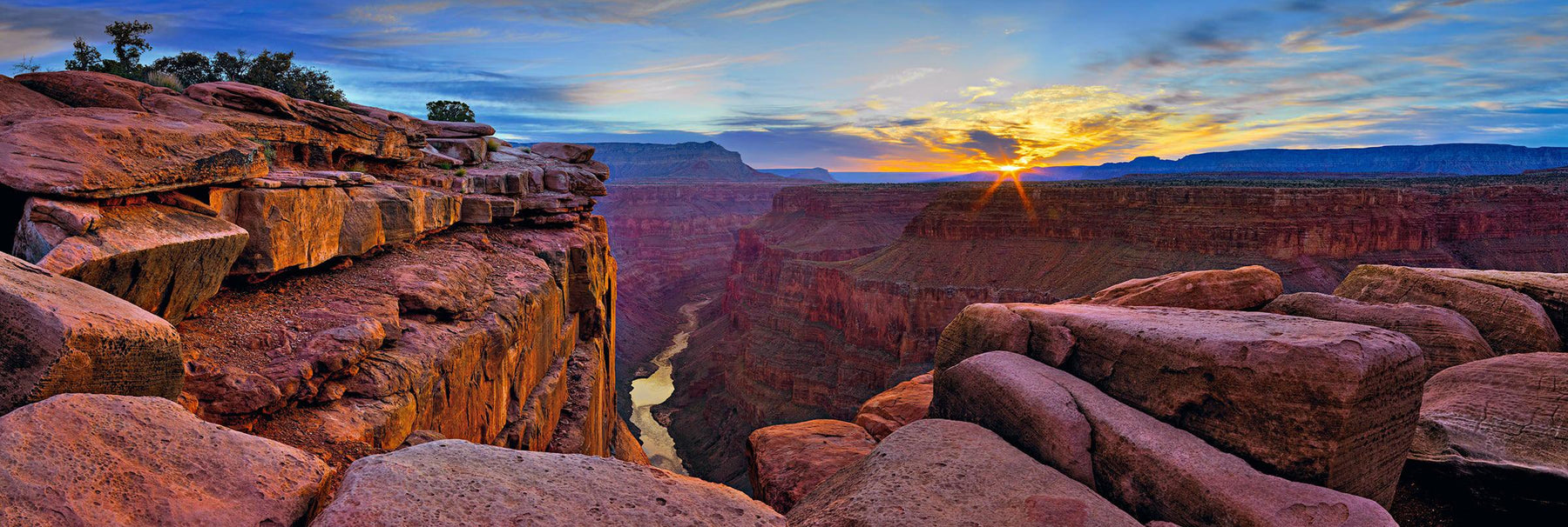Red rock cliffs overlooking the Colorado River and Grand Canyon National Park Arizona at sunrise