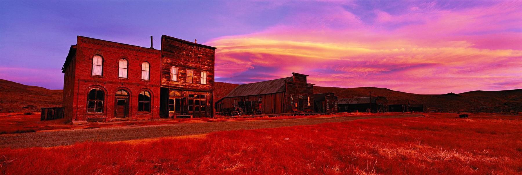 Old buildings in the abandoned ghost town of Bodie California at sunrise