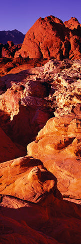 Red and orange sunlit sandstone formations and canyons of Valley of Fire State Park Nevada