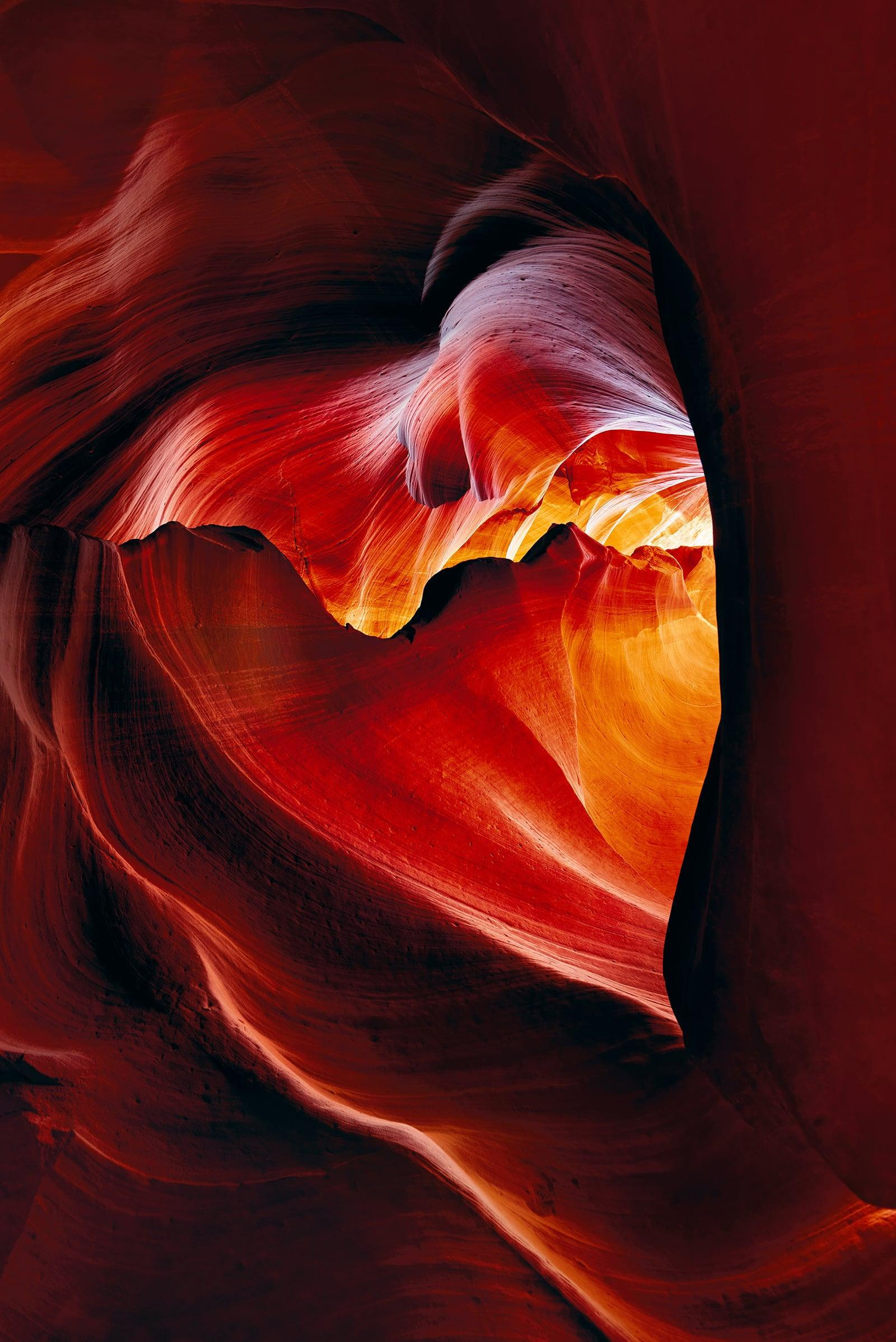 Red and orange heart shaped sandstone cavern within the slot canyons in Antelope Canyon Arizona