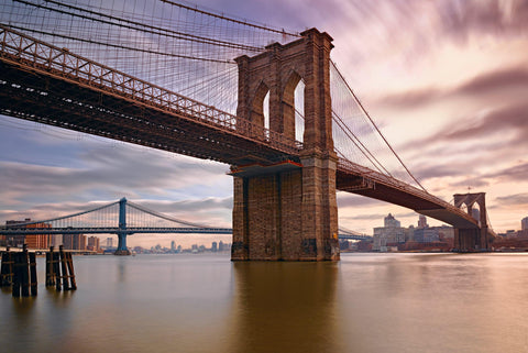 Brooklyn Bridge from the waters edge with the Manhattan Bridge and New York City in the background