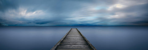 Old wood jetty stretching out over a calm lake in Seattle Washington