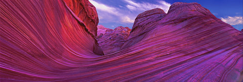 Pink and purple wave like rock formations in the slickrock hills of Vermillion Cliffs National Park Arizona