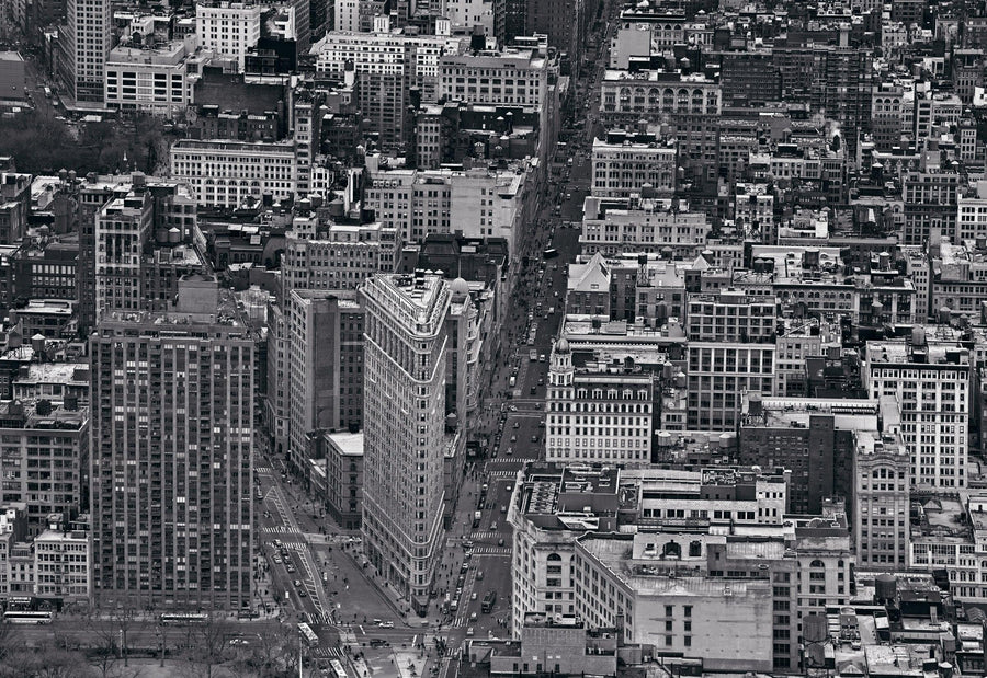 Black and white rooftop view of the Flatiron Building and the surrounding neighborhoods in New York