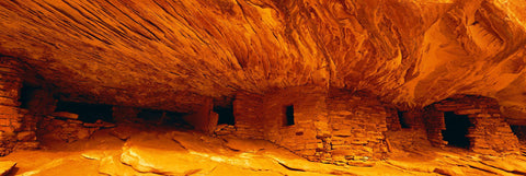 Ancient Anasazi ruins built into the rock walls off a plateau in Cedar Mesa Utah