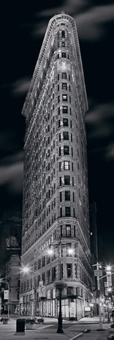 Looking up at the triangle shaped Flatiron building from the streets of New York City